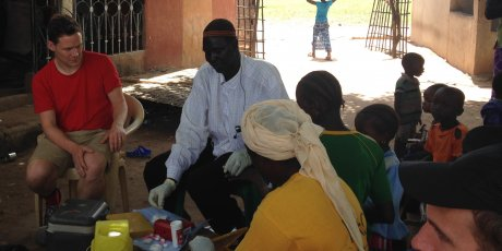 Testing malaria infections: blood sample collections in a village near Basse, The Gambia. Photo credit: Ellen Leffler.